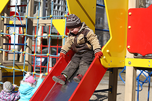 Boy going down slide